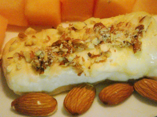 Gorgonzola mascarpone torta, drizzled with honey, and topped with almonds
